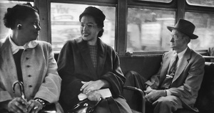 Rosa Parks (C) riding on newly integrated bus following Supreme Court ruling ending successful 381 day boycott of segragated buses. Boycott began when Parks was arrested for refusing to give up her seat to a white person.